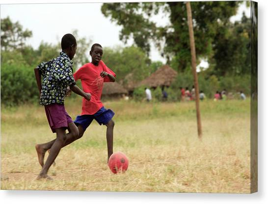 Boys Playing Football Canvas Print by Mauro Fermariello/science Photo Library