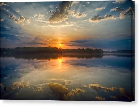 Breaking Through The Clouds Canvas Print by Dan Holland