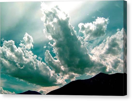 Bright Clouds Canvas Print by Mavis Reid Nugent
