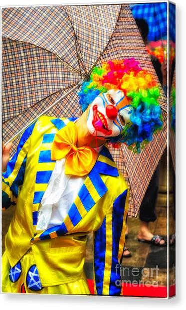 Brightly Dressed Clown With Umbrella Canvas Print
