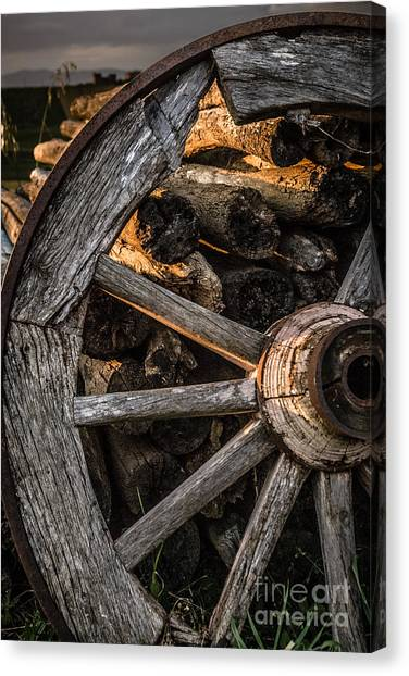 Broken Cart Wheel With Missing Spoke And Logs On A Farm At Pacia Canvas Print