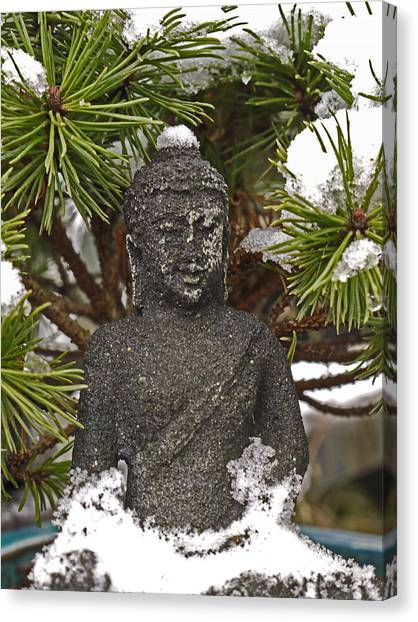 Buddha In The Snow Canvas Print
