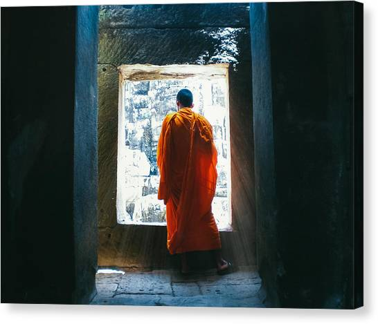 Buddhist Monk In Bayon Temple Angkor Wat Canvas Print by Leander Nardin