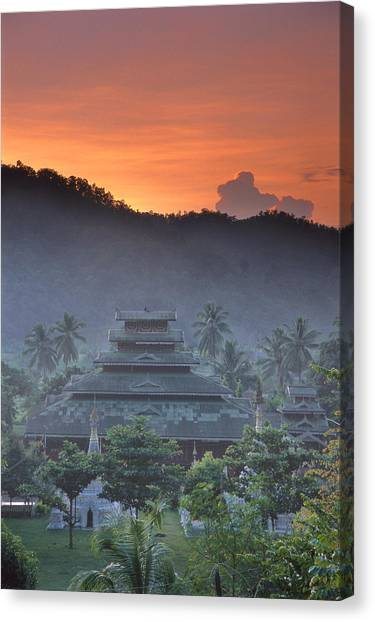Buddhist Temple At Sunset Canvas Print by Richard Berry