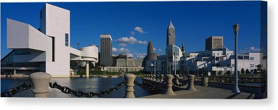 Chain Link Fence Canvas Print - Building At The Waterfront, Rock And by Panoramic Images