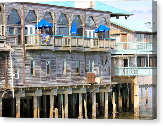 Building On Piles Above Water Canvas Print
