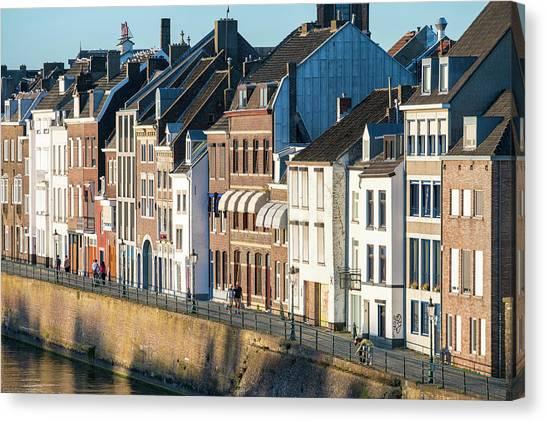 Limburg Canvas Print - Buildings Along Meuse River by Jason Langley