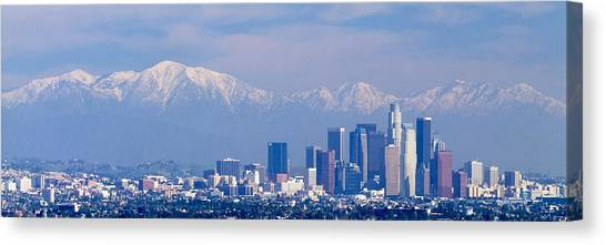 San Gabriel Canvas Print - Buildings In A City With Snowcapped by Panoramic Images