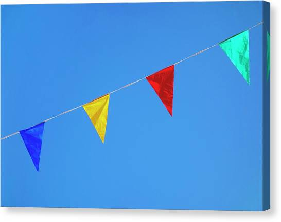 Bunting Canvas Print - Bunting Against A Blue Sky by Cordelia Molloy