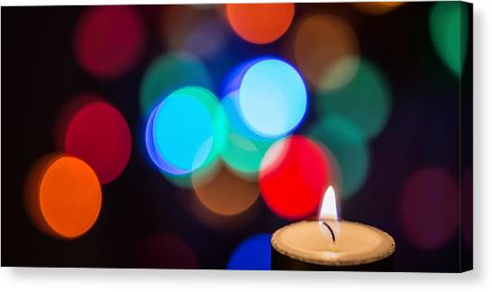 Diwali Canvas Print - Burning Candle With Colorful Bokeh by Vishwanath Bhat