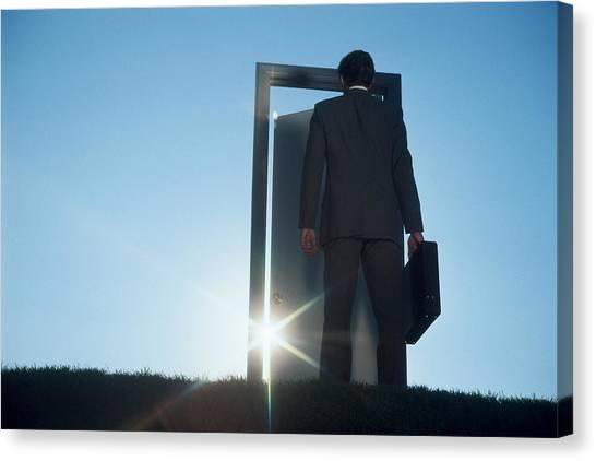 Businessman Entering Door Outdoors Canvas Print by Comstock
