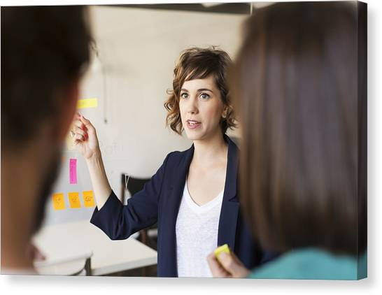 Businesswoman Giving Presentation Canvas Print by Morsa Images