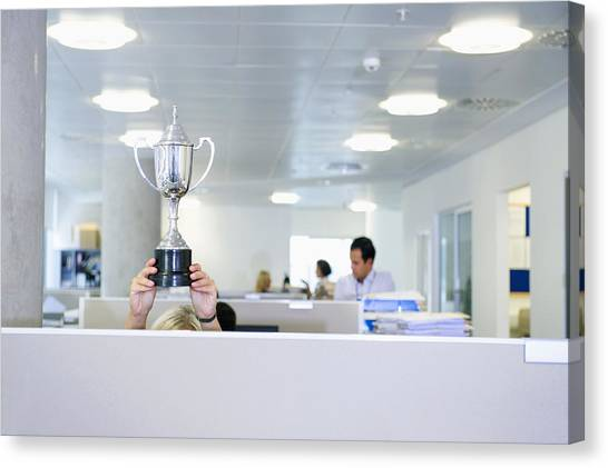 Businesswoman Holding Trophy Over Office Cubicle Canvas Print by Jacobs Stock Photography Ltd