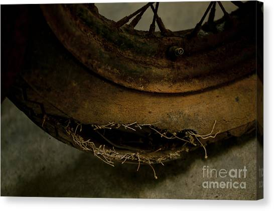 Busted Motorcycle Tire Canvas Print