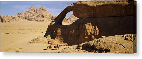 Jordan Canvas Print - Camels At The Eye Of The Eagle Arch by Panoramic Images