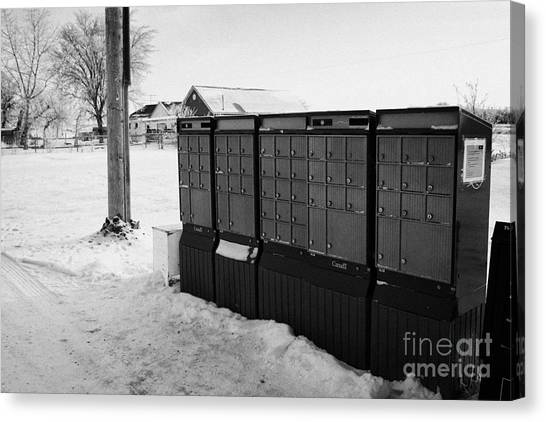 Harsh Conditions Canvas Print - canada post post mailboxes in rural small town Forget Saskatchewan Canada by Joe Fox