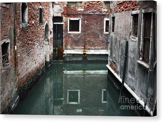 Canal Reflections Canvas Print by John Rizzuto