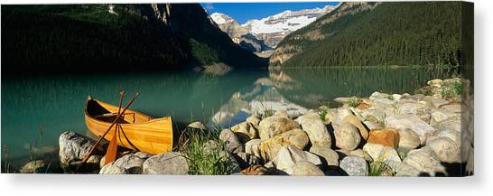 Canoe Canvas Print - Canoe At The Lakeside, Lake Louise by Panoramic Images