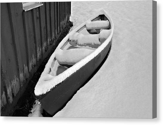 Canoe In The Snow Canvas Print