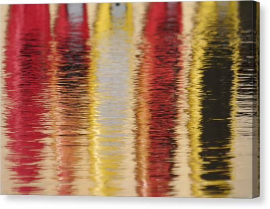 Canoe Reflections Canvas Print by Carolyn Reinhart