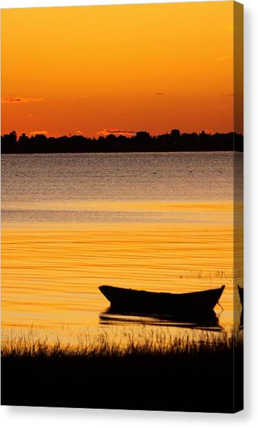 Canoe Sunrise Canvas Print by Brian Magnier