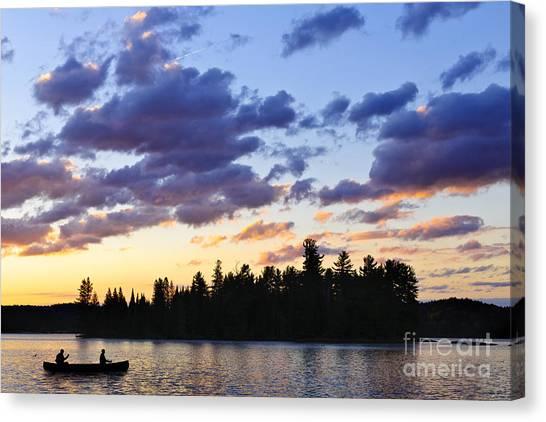 Lake Sunrises Canvas Print - Canoeing At Sunset by Elena Elisseeva