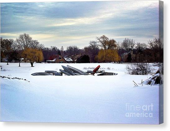 Canoes In The Snow Canvas Print