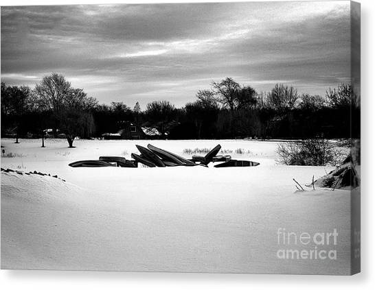 Canoes In The Snow - Monochrome Canvas Print