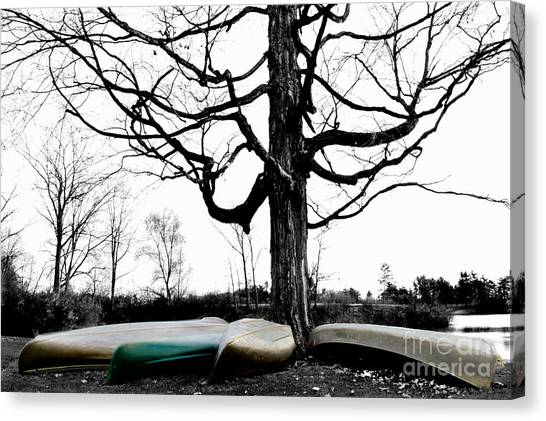 Canoes In Winter Canvas Print