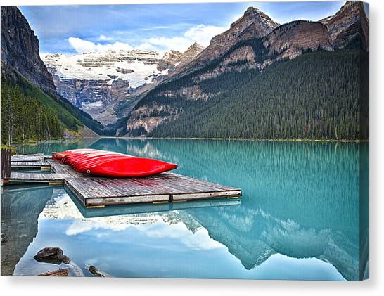 Alberta Canvas Print - Canoes Of Lake Louise Alberta Canada by George Oze