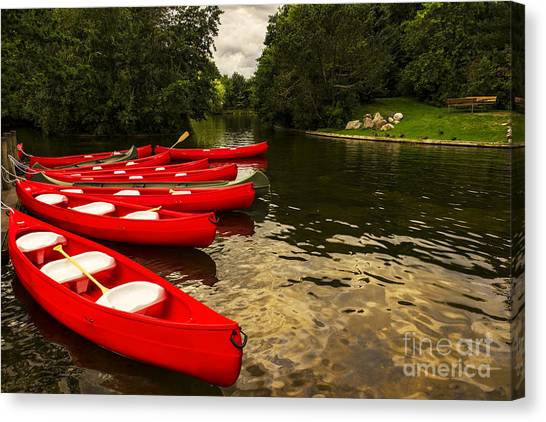 Canoes On A Lake Canvas Print