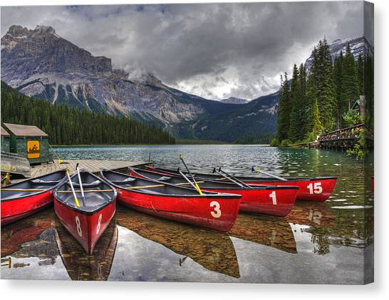 Canoes On Emerald Lake Canvas Print