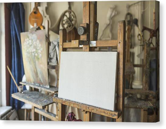 Canvas On Easel In Art Studio Canvas Print by Vladimir Godnik