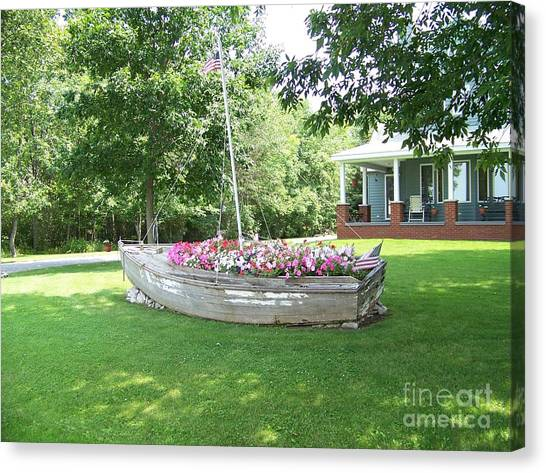 Cape Vincent Flowerboat Canvas Print by Kevin Croitz