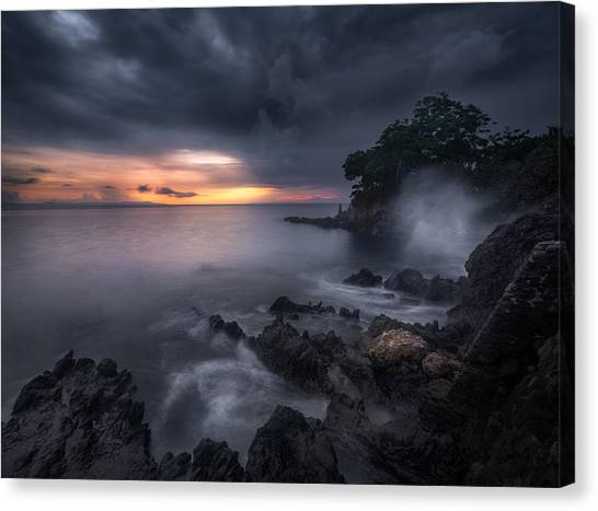 Ocean Sunsets Canvas Print - Caprusan Temple Sunset by Ade Rizal