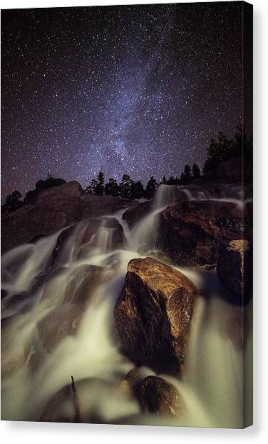 Capturing A Starry Night Waterfall In Canvas Print