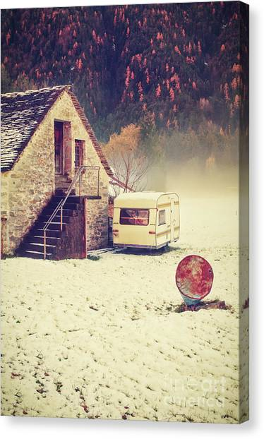 Caravan In The Snow With House And Wood Canvas Print