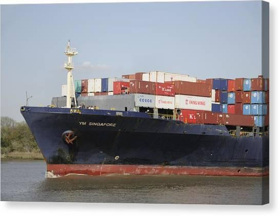 Cargo Ship On The River Canvas Print by Bradford Martin