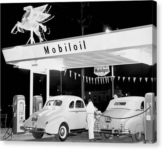 Attendant Canvas Print - Cars At A Mobil Gas Station by Underwood Archives