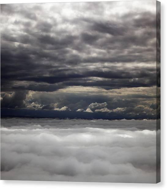 Caught Between Two Cloud Layers Canvas Print by Michael Riley