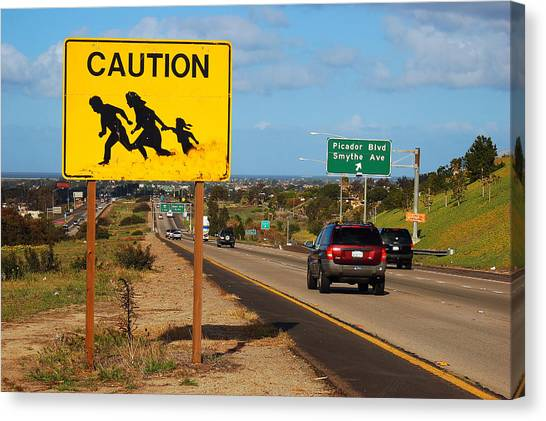 Illegal Aliens Canvas Print - Caution Crossing by James Kirkikis