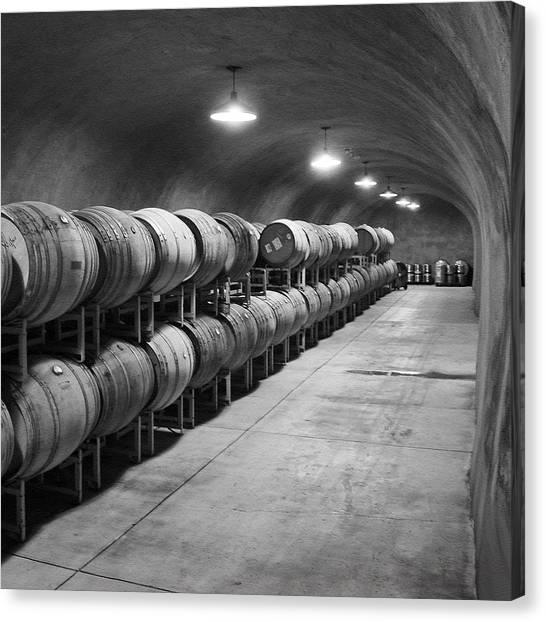 Cave Storage Of Wine Barrels Canvas Print by Kent Sorensen