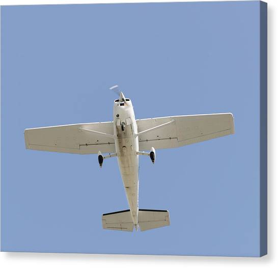 Cessnas Canvas Print - Cessna 172 Skyhawk Light Aircraft In Flight by Aviation Images / Science Photo Library