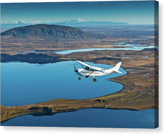Cessnas Canvas Print - Cessna Flying Over South Coast Iceland by Panoramic Images