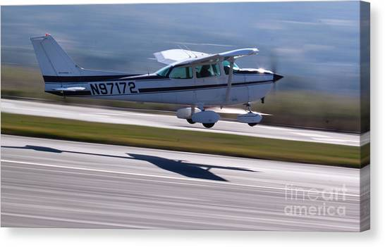Cessnas Canvas Print - Cessna Takeoff by John Daly