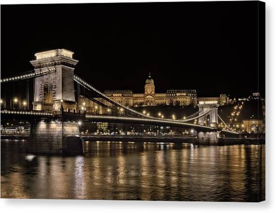Danube Canvas Print - Chain Bridge And Buda Castle Winter Night by Joan Carroll