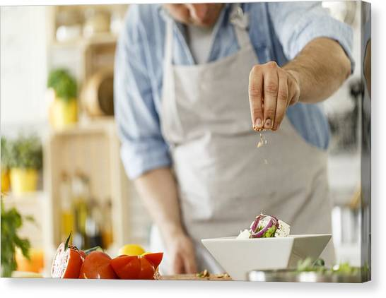 Chef Decorating A Plate With Healthy Salad Canvas Print by Fotostorm