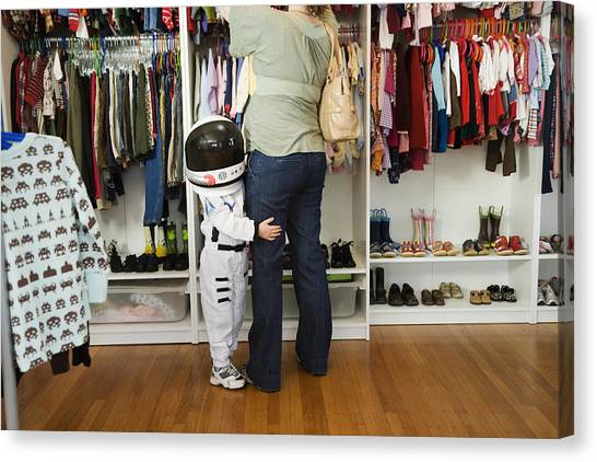 Child (4-5 Yeras) Wearing Space Costume Hugging Mother's Leg In Shop Canvas Print by Inti St. Clair