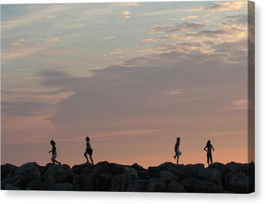 Children Paying At Sunset Time Canvas Print by Carolyn Reinhart