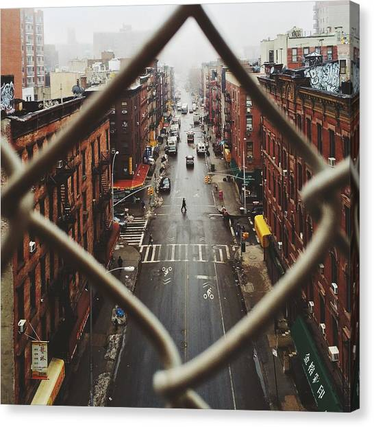 Chinatown Seen Through Fence On A Foggy Canvas Print by Alexander Spatari